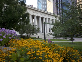 slideshow image The northern facade of the Ohio Statehouse is flanked by colorful flowers.